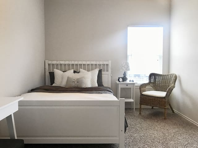 A home away from home! Comfy, modern room for two.