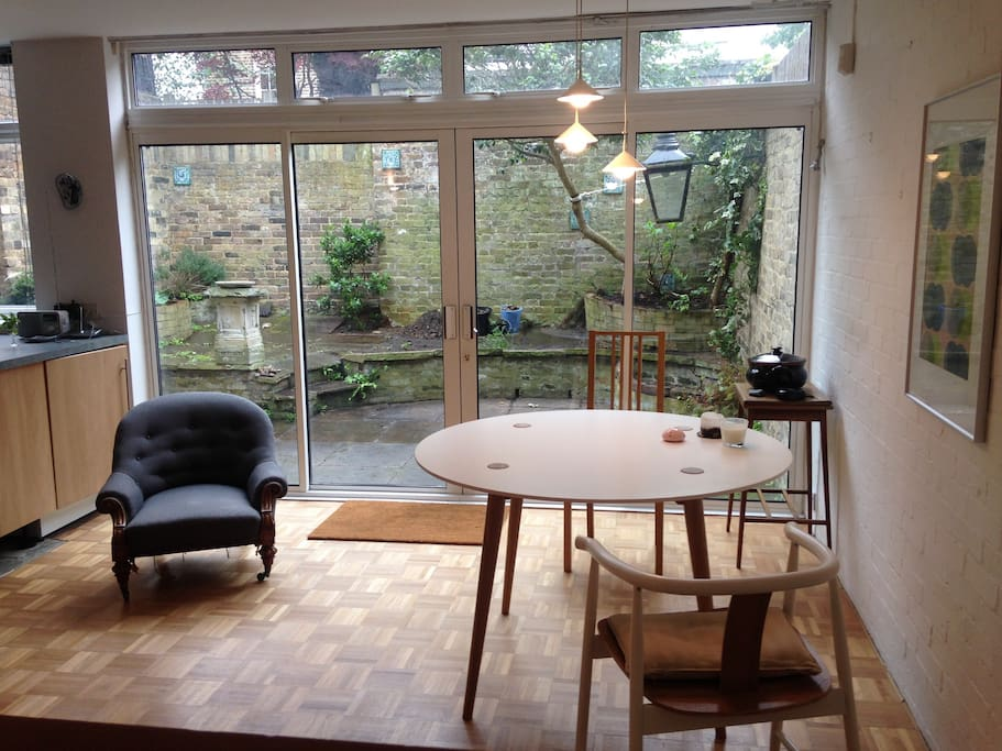 Living/dining room with open plan kitchen and generous patio garden