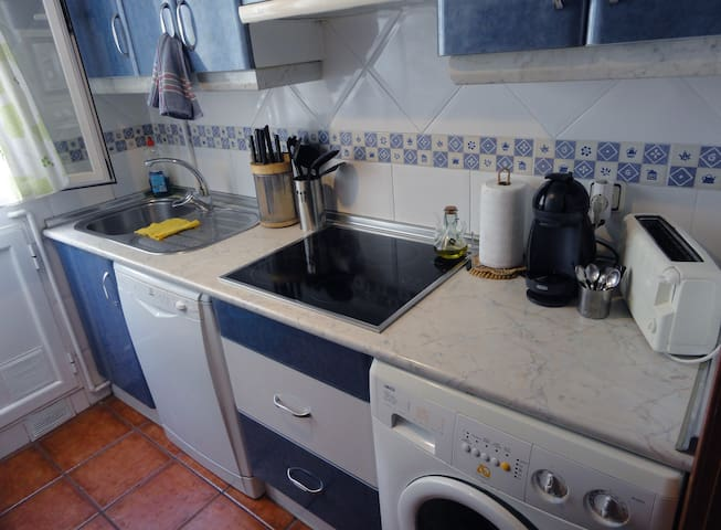 Access to KITCHEN equipped with Coffee Maker, Toaster, Electric Stove Top, Refrigerator, Microwave Oven, Dishes, Pots and Pans and lots of natural light