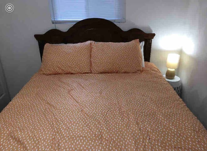 Queen bedroom with new comforter and lake view.