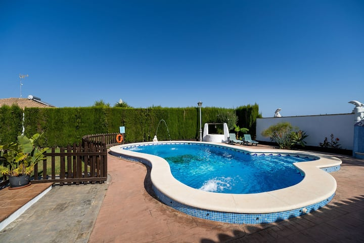 Holiday Home Cortijo Entrepinares with Pool, Wi-Fi, Garden & Terrace; Parking Available