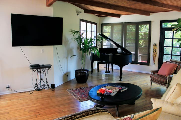 """LG - 65""""  OLED  4K, U-verse On Demand TV, wifi, Baby Grand Piano, a/c, 8ft couch, 6ft chaise, fireplace, wood beam ceiling, french doors"""