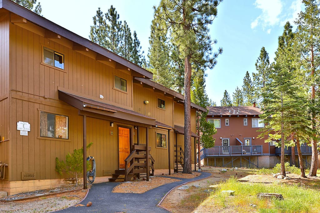 This charming home is surrounded by magnificent pines.