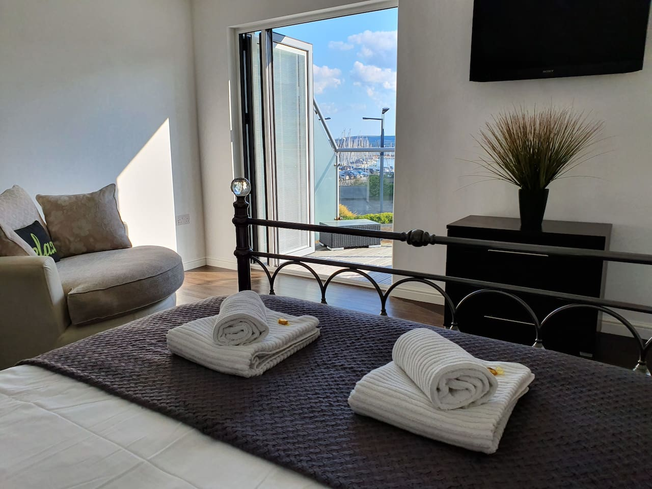Master-suite views towards the Purbecks, inner Harbour and yacht club.