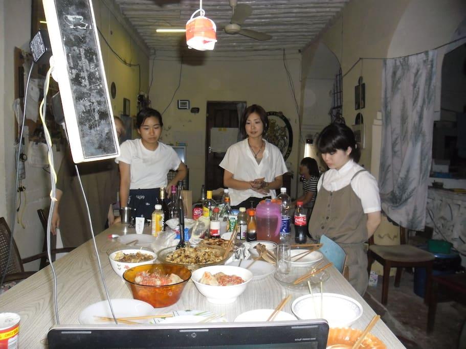 Japanese students from Nagasaki university prepare for dinner