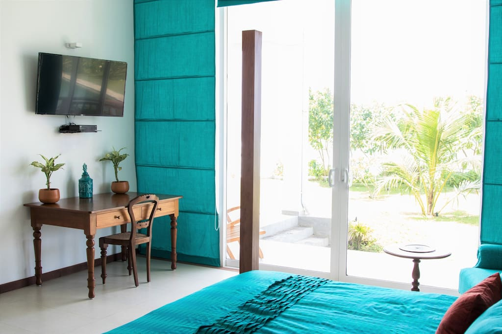 Ocean suite with large vista windows looking out at the beach at Parrotfish Bay, Sri Lanka