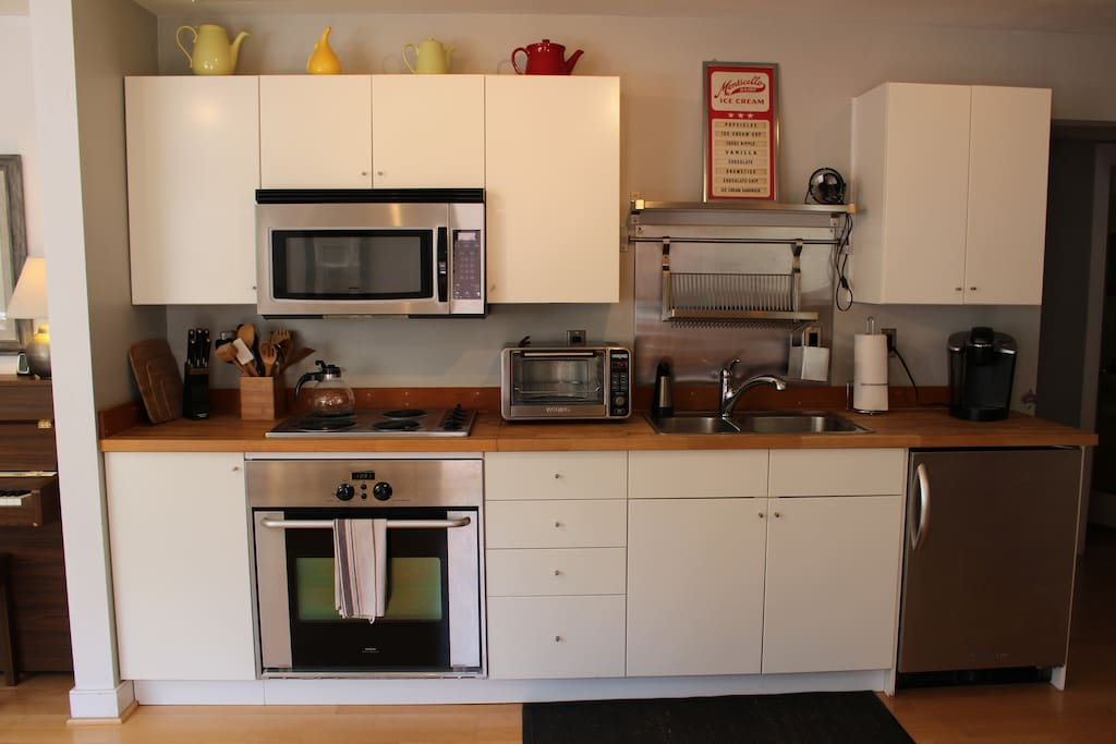 Kitchen amenities include a full-sized oven/stove, Keurig, toaster oven, microwave & full-sized fridge (not pictured)
