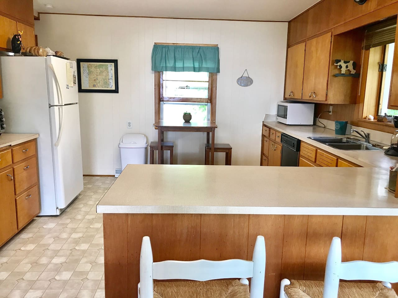 Kitchen perfect for gathering, opens to large deck