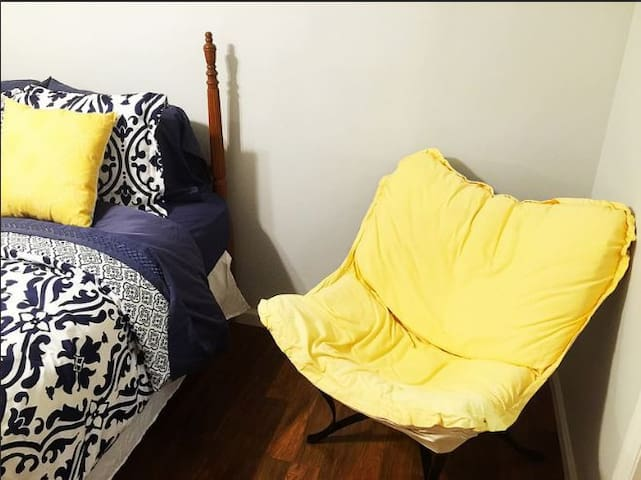 Lower Bedroom with Yellow Chair
