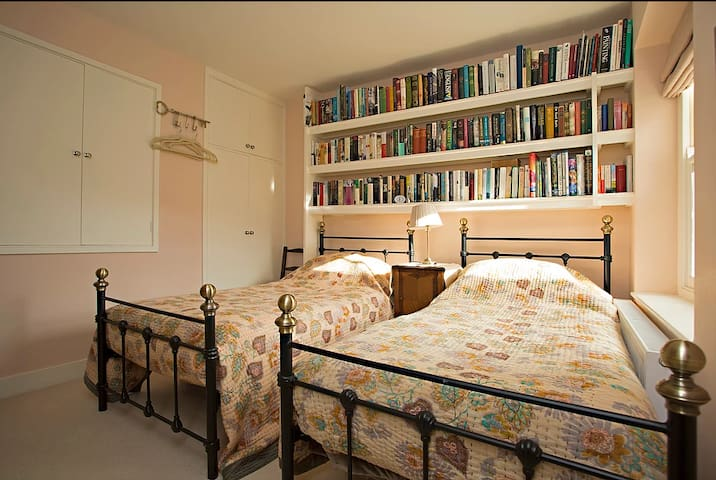 Twin bedded room with plenty of books to read