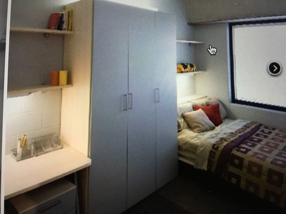 Private bedroom with cabinet and desk