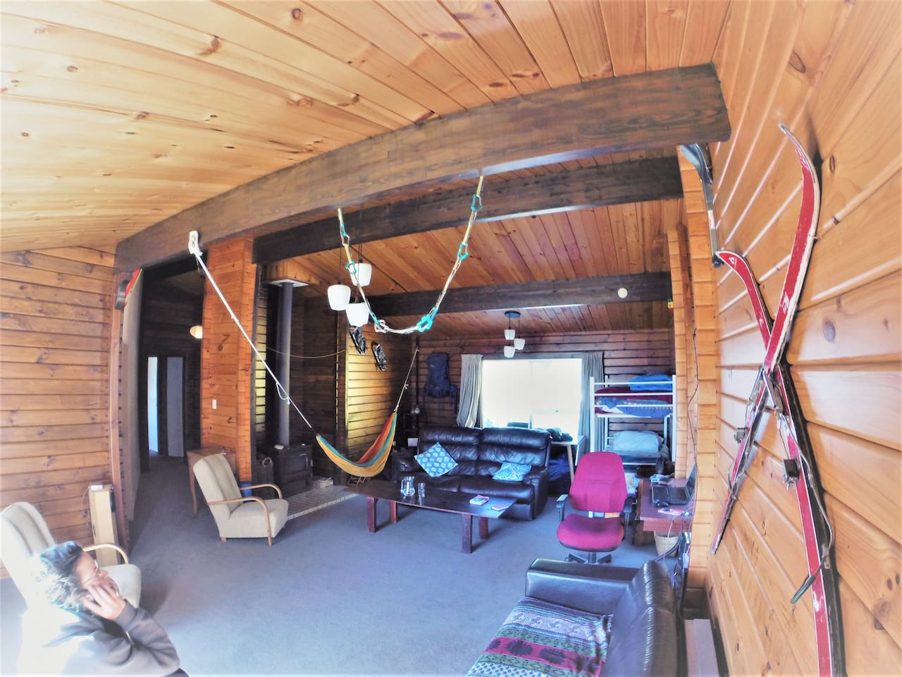 The common/living area in our home has a few special features like a hammock, a wholesome audio system, guest bunk beds and we even have hang points for testing paragliding harnesses (just in case) and a nice warm fire.