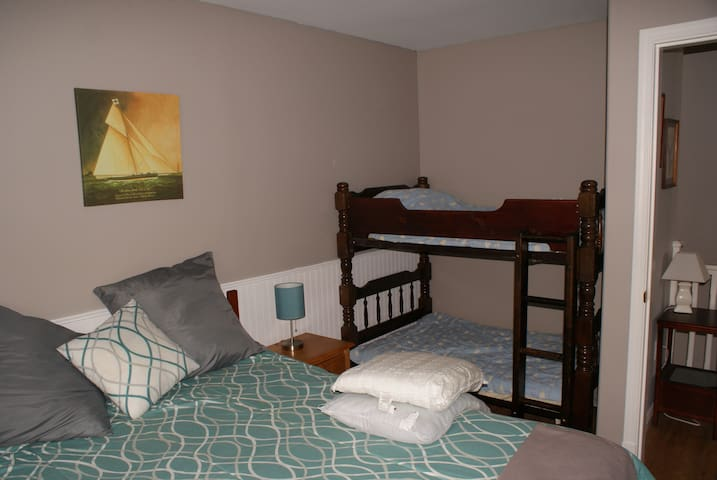 Queen bed and two 5ft bunks