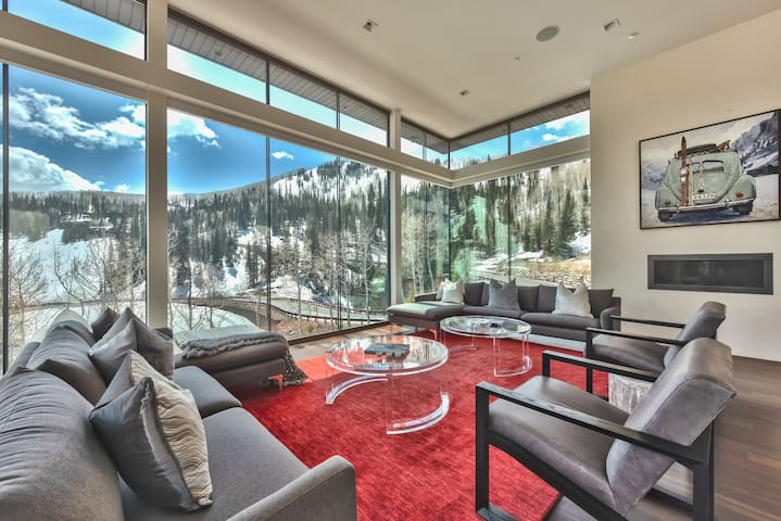 The Stunning Views Start at the Entry Living Room with Floor to Ceiling Windows and Modern Decor