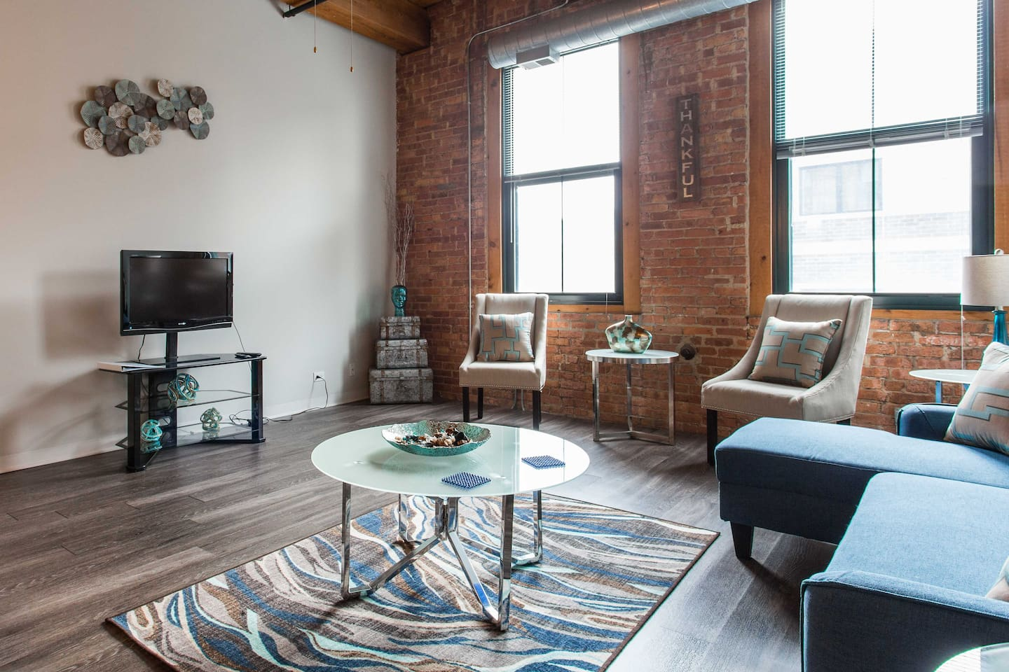Spacious living room with sofa pullout and TV with streaming Hulu live, Netflix and others