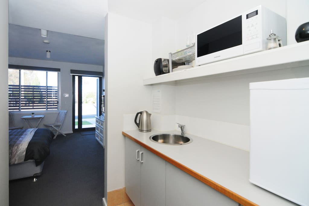 Kitchenette including small bar fridge, toaster, kettle, microwave etc.