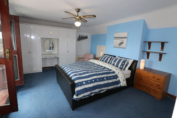 Large master bedroom with its own indoor balcony for you to enjoy views over the Solent.