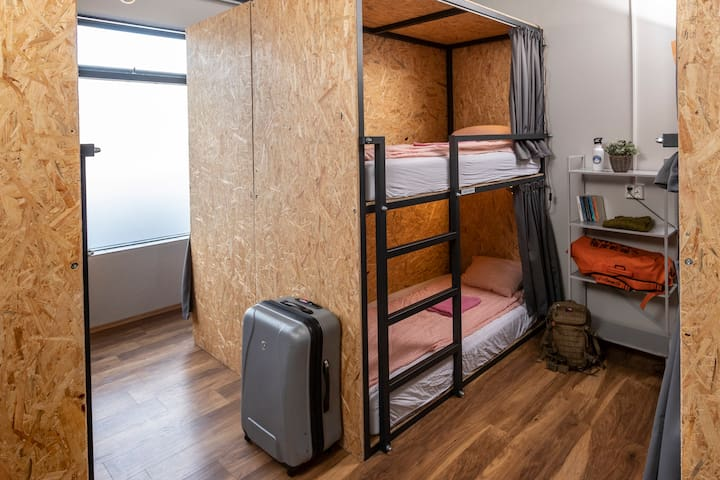 Single Enclosed Bunk Bed in 8-Bed Dorm Room