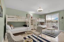 1st floor bunk room.  Sleeps 6 with sliders to deck and jack and jill bath.  Designed for sitting and entertainment space, this room has a 5 player Nintendo Wii for virtual reality fun on a rainy day.