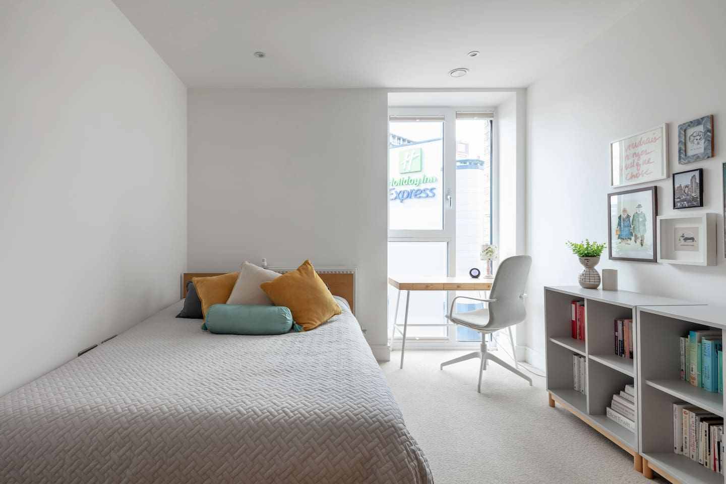 The bedroom. Includes a desk and plenty of surface space for your stuff.