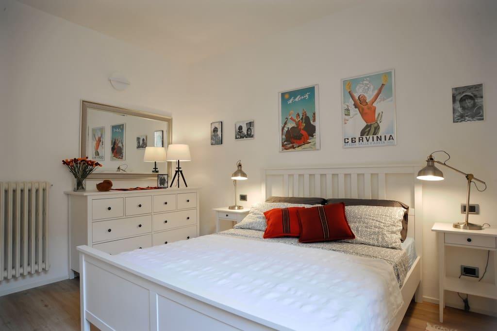 Bedroom is equipped with large chest of drawers and a wall to wall closet