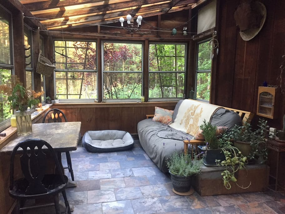 Our garden sun room is great for relaxing on the couch / futon in the sun during the day and star gazing at night.    The sun room futon is also a great place for additional guest to sleep at night under the stars
