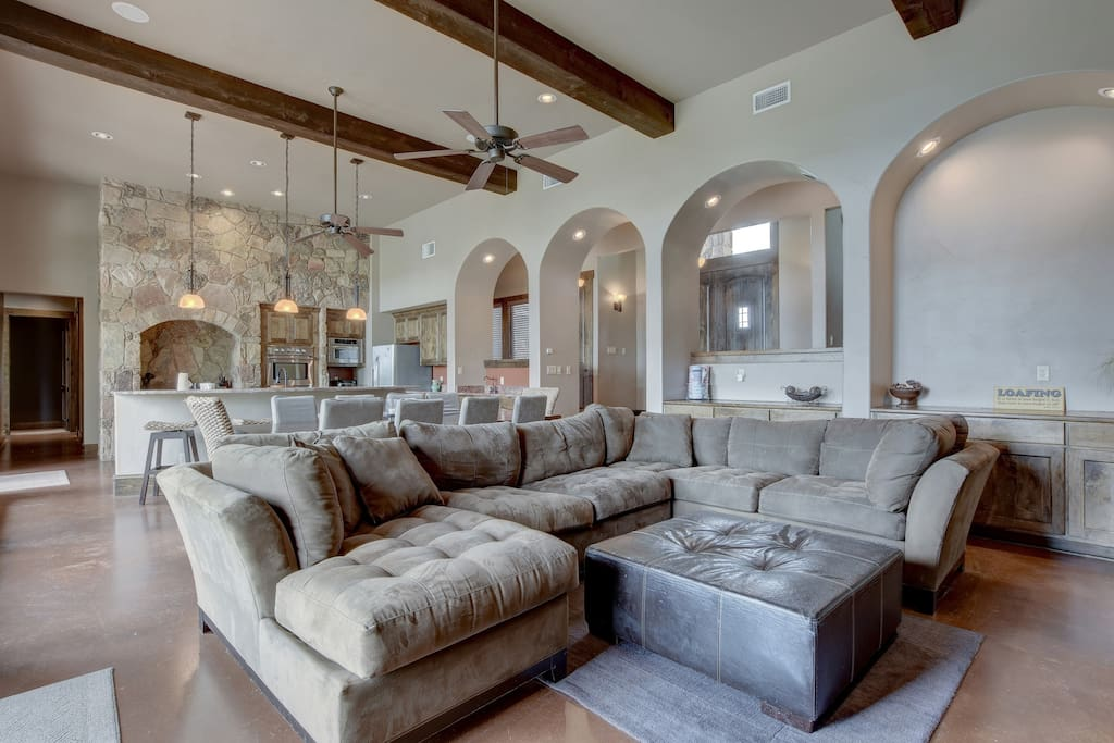 Kick back on a suede sectional couch in the open-concept living area.