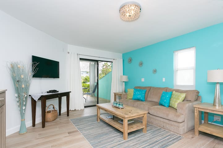 The living area opens onto the patio and the sofa opens up quickly to a comfortable queen bed