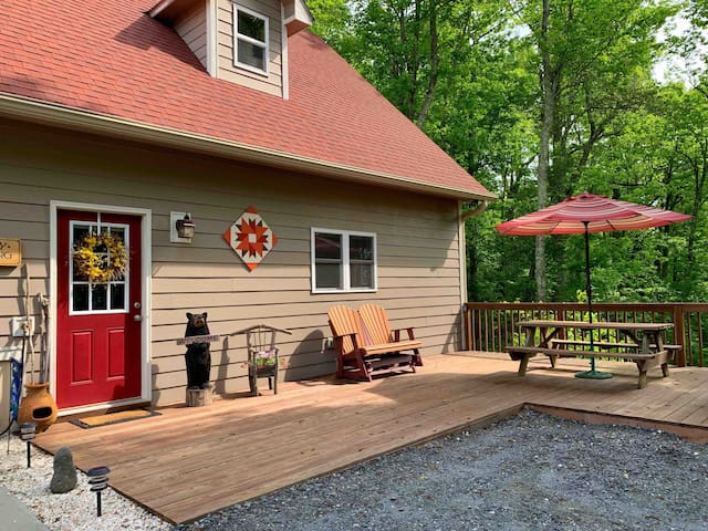 Entrance to guesthouse is located to the far right of the garage. The guesthouse has its own deck, picnic table and gas grill