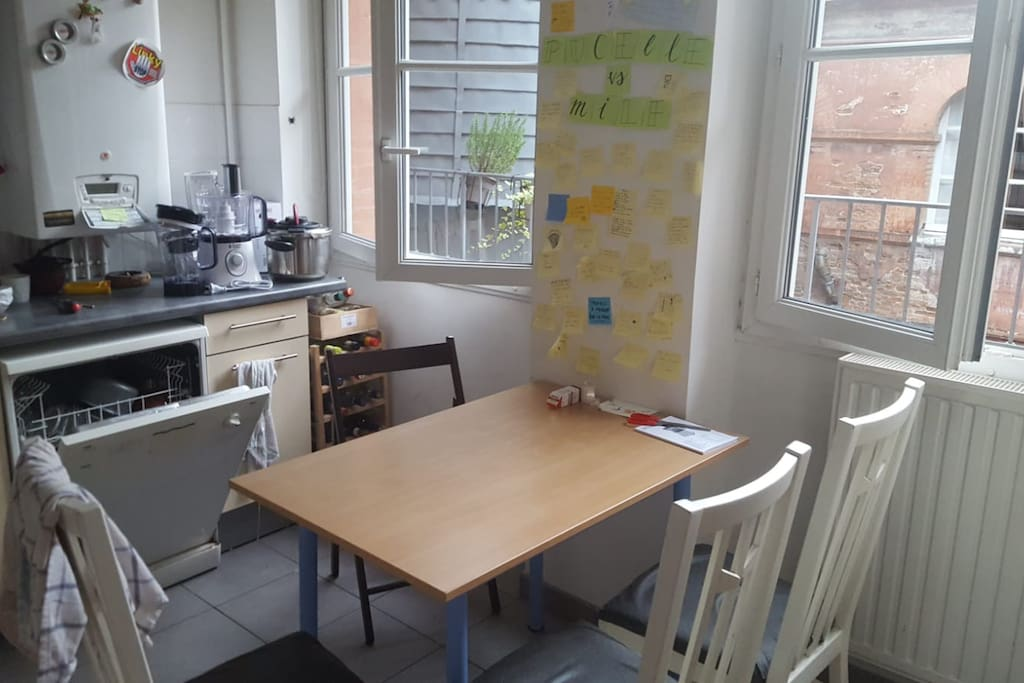 The table in our fully equipped kitchen