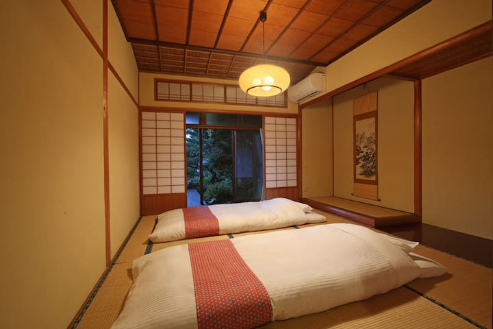 Bedroom 2 with thick futon beds up to 3 people. 和室ベッドルーム2(最大3名)