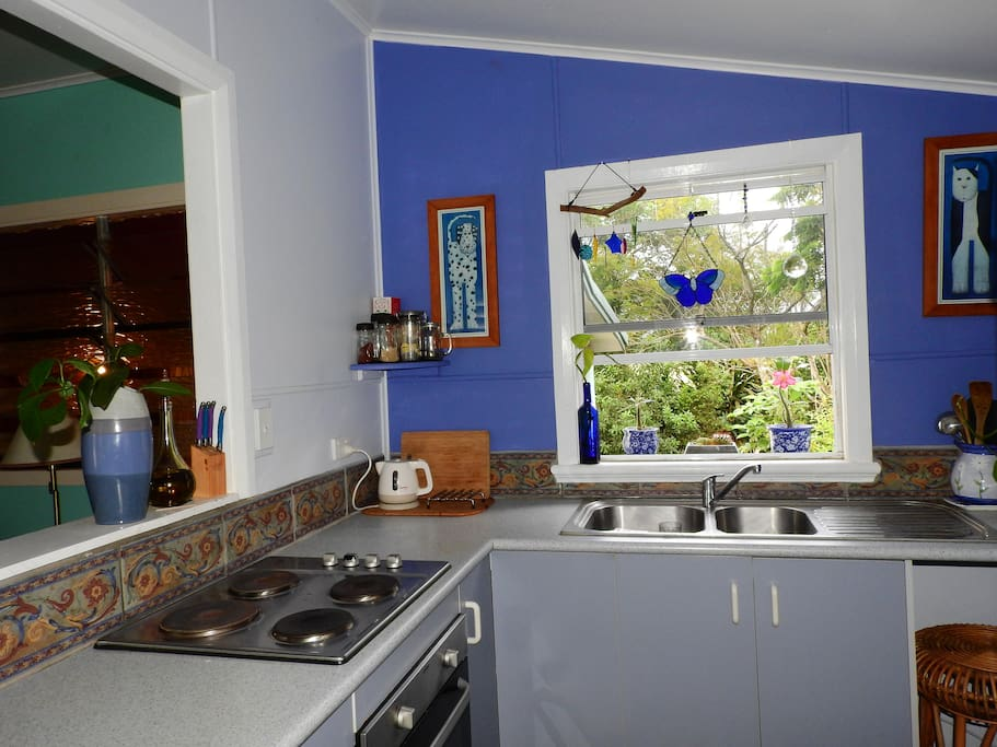 The kitchen with its very own window garden! The fridge has an ice dispenser for those hot sunshiny days!