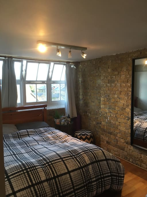 Bedroom with queen sized bed. View of the shard and cityscape from bedroom!