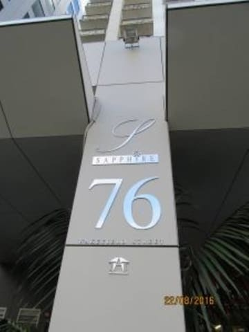 This is the building sign located on the pillar