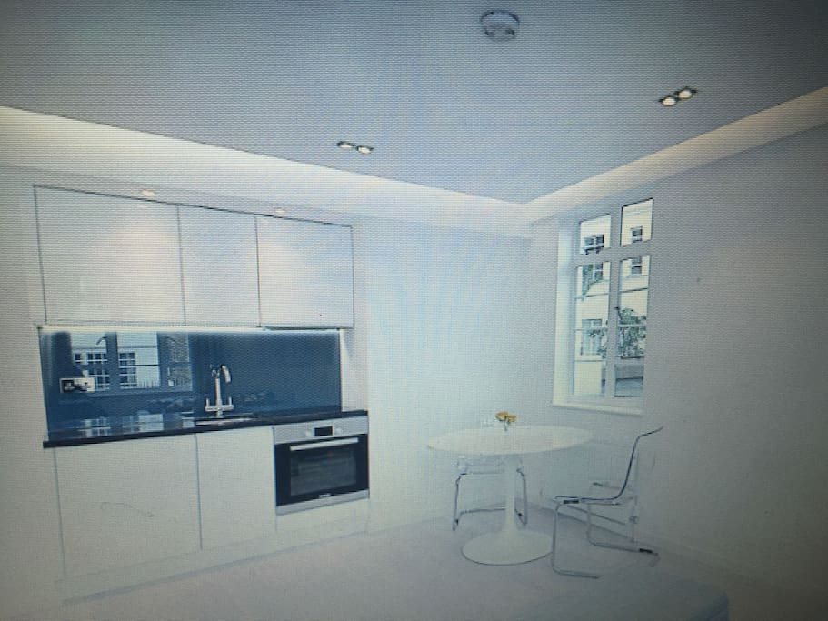 beautiful kitchen with washer dryer and electric hob