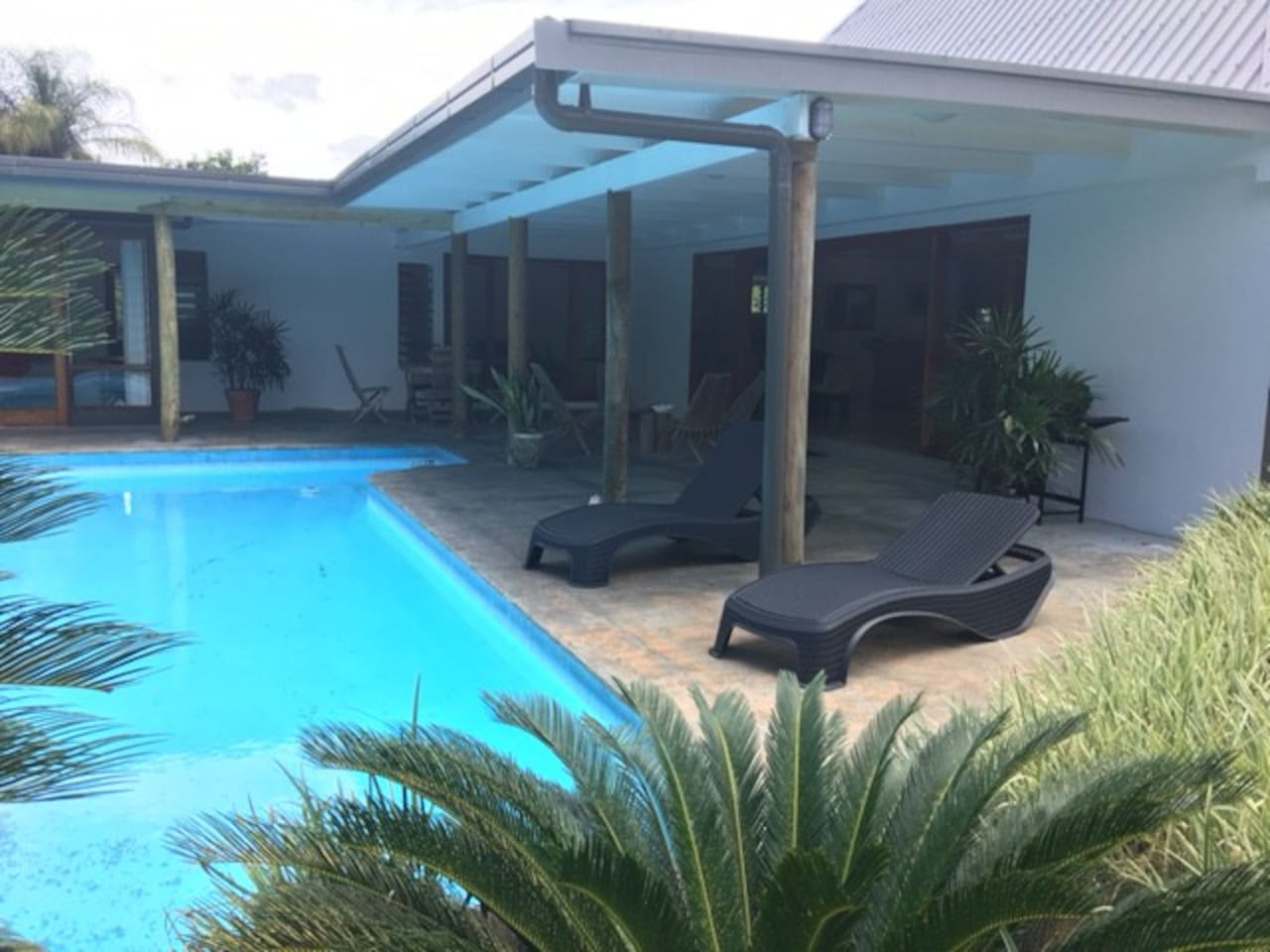 loungers and pool area