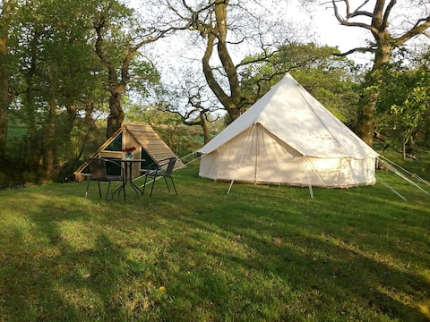 Bell tent with own bathroom in woods with stream.