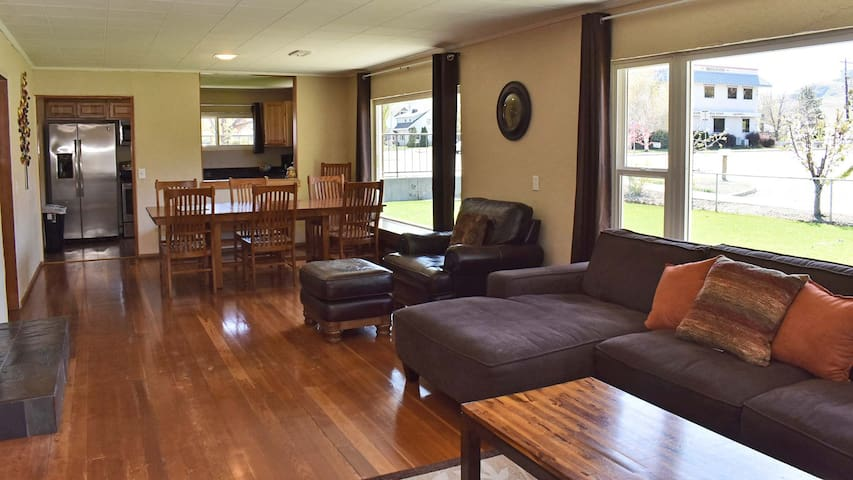 Open living and dining areas with huge windows across the front