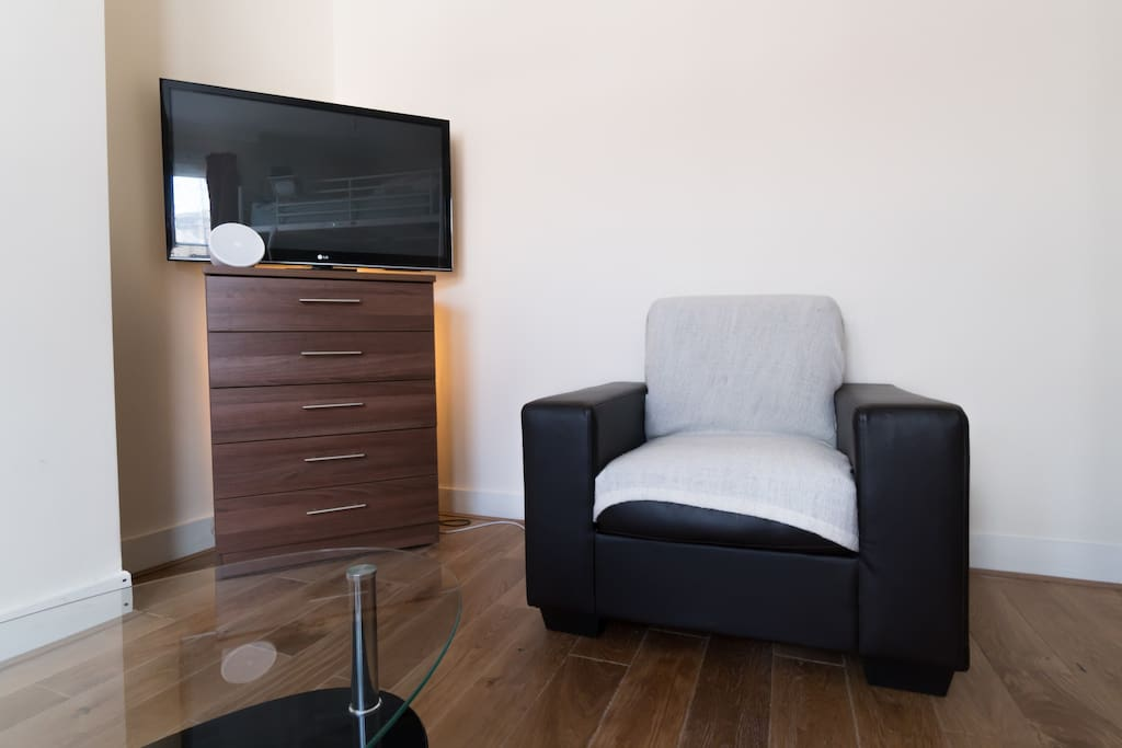 42'' LCD Tv and cozy sofa