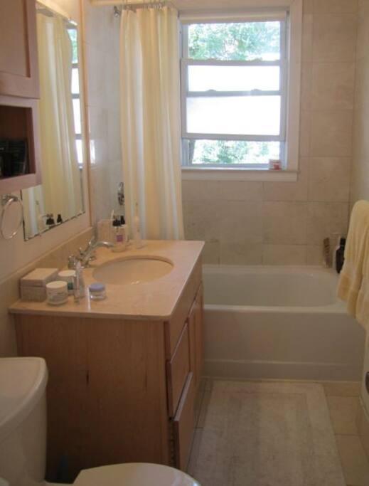 Modern, shared bathroom.