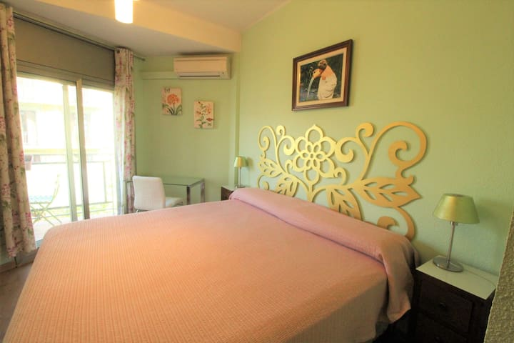 Main bedroom with balcony and air-conditioned