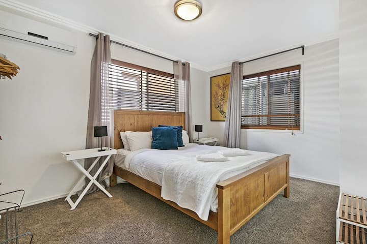 Bedroom with queen bed + air con (main level)