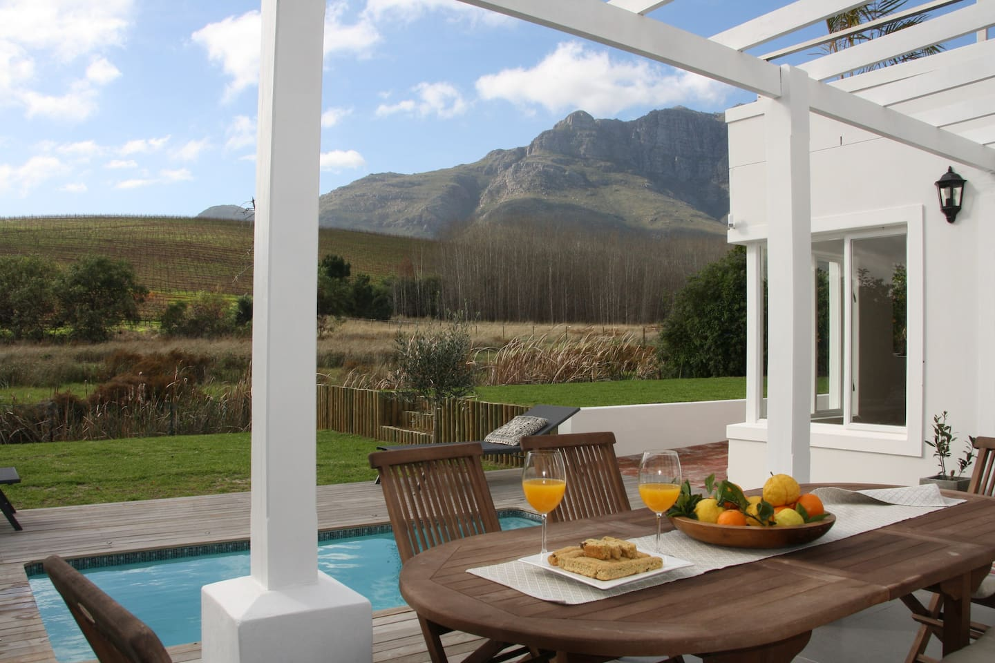 Patio overlooking splash pool, and spacious private garden with views of the Hottentot Holland Mountain Range