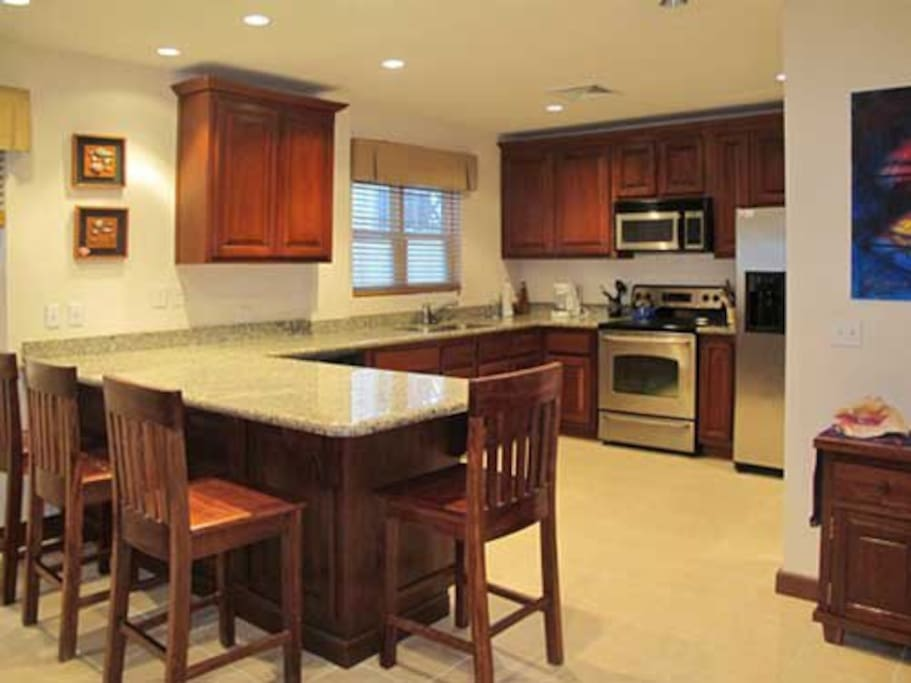 Spacious open kitchen.  Flows into dining and sitting rooms.  L shaped.