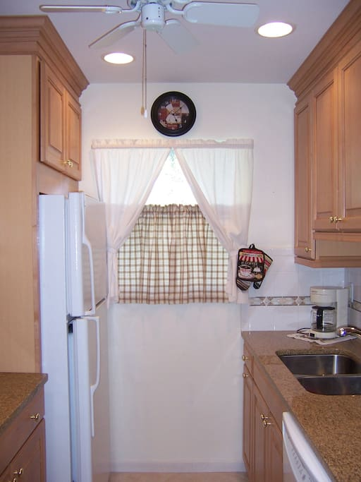 Kitchen updated 2008. Maple cabinets with pullouts, tile foor, high hat lighting fully equipped.
