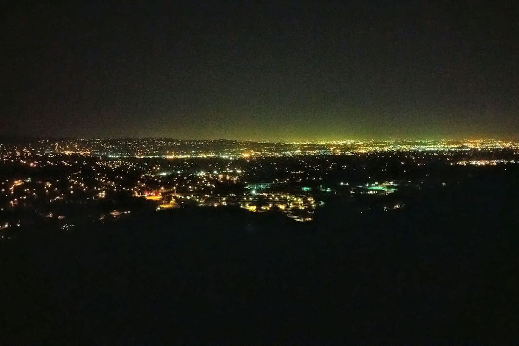 View at night from private patio. On clear days you can see all the way to the ocean and Catalina Island. Truly an amazing view at any time of the year.