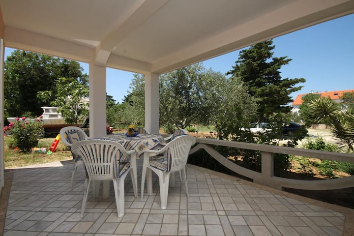 Two bedroom apartment with terrace Novalja, Pag (A-6490-a)