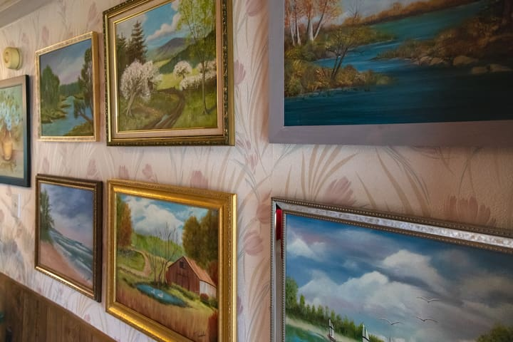 A closer look at Mama Margie's artwork. She never thought of herself as an artist, she just enjoyed learning as she went. She painted a few things over the years, and we love being able to share them with our guests.