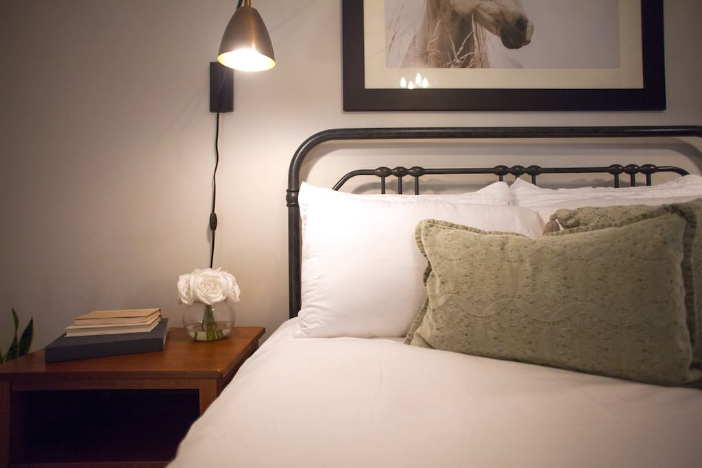A warm and inviting queen bed awaits