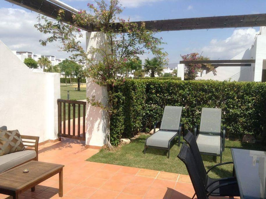 Private garden with easy access to the play area and pool